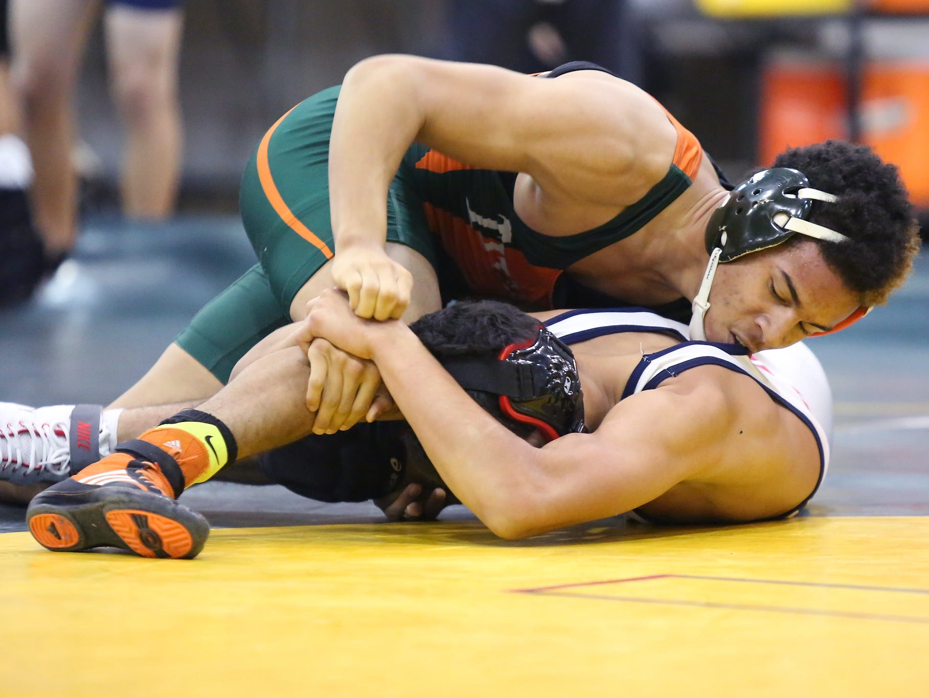 East Ramapo's Romello Bradley, top, wrestles Yonkers' Fredy Guevara in a 145-pound match during the quad meet for the Section 1 dual meet championships at Ramapo High School in Spring Valley on Wednesday, Dec. 2, 2015. East Ramapo defeated Yonkers 53-29 and advances to the semifinals.