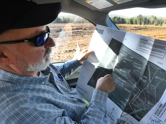 Trey Lee the Rutherford County Project Manager shows a map of the property were the land is currently being cleared for the site of 2 Rutherford County schools at the Rocky Fork Road property in Smyrna, on Tuesday, Jan. 12, 2016.
