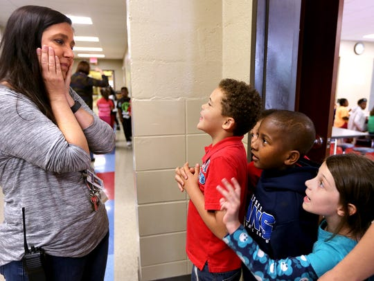 Hobgood principal Tammy Garrett, left, interacts with