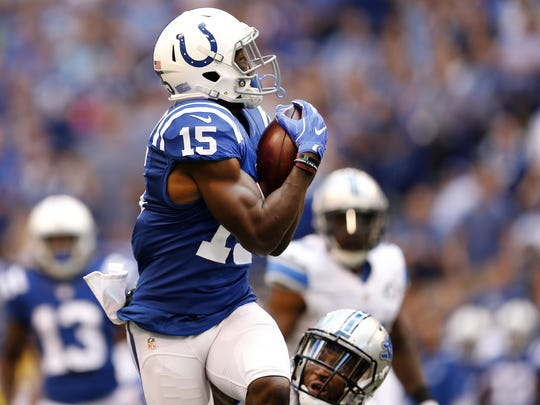 Indianapolis Colts wide receiver Phillip Dorsett (15) pulls in a big catch against the Detroit Lions at Lucas Oil Stadium on Sept. 11, 2016.