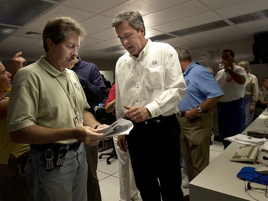 Former Florida Governor Jeb Bush spoke with Martin County Administrator Russ Blackburn after a press conference concerning Hurricane Jeanne at the Martin Co. Emergency Operations Center in 2004.