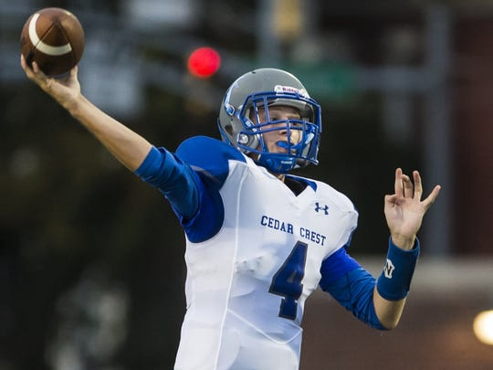 Cedar Crest's Logan Horn delivers a pass during the annual Cedar Bowl on Friday, Sept. 2, 2016.