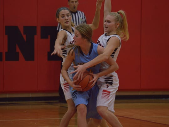 River Valley's Taylor Hecker is trapped by Pleasant's