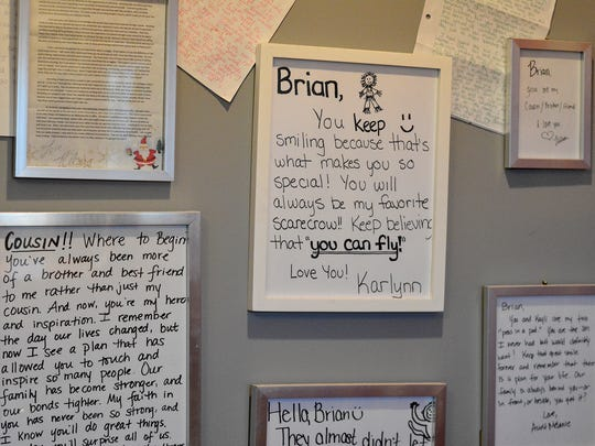 Notes from friends and family cover the walls of Brian