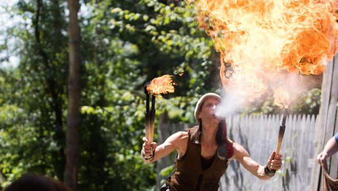 """The Idiot"" from the show Ric Roc blows fire for the audience at BlackRock Medieval Fest last year."
