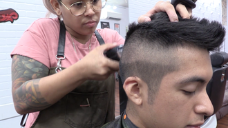 Cassandra Mendoza first starts off by shaving the middle section of the hair before proceeding onto the fade.