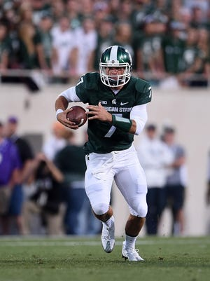 Tyler O'Connor runs for yards during the first half of a game against the Furman Paladins at Spartan Stadium on Sept. 2.