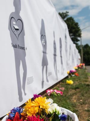 A banner bearing the names of the 26 victims of the 2012 Sandy Hook shooting is shown during a July 14 protest demanding justice for Philando Castile, who was killed in July 2016 by a St. Anthony, Minnesota, police officer. Protestors went from in front of the NRA headquarters in Fairfax, Virginia, to the Department of Justice in Washington, D.C.
