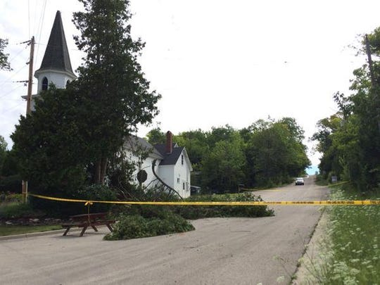 Some roads, like Waters End Road near Sister Bay, were still blocked Monday morning as Door County worked to get back to normal following severe thunderstorms Sunday.