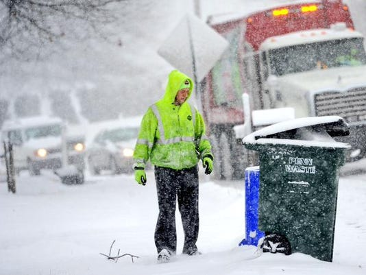A Penn Waste employee collects trash in the snow. (Jason Plotkin - Daily Record/Sunday News)
