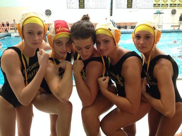 The Lady Aves are muscled up and ready to hit the pool for water polo coach Nick Hellwig. From left are senior captain Hannah Kast, junior Hannah May, senior captain Hannah Schwegmann, senior captain Jory Gould and senior Paige Parr.