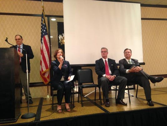 A moderator (left) introduces York County Commissioner candidates (from left) Susan Byrnes, Chris Reilly and Kelly Henshaw.