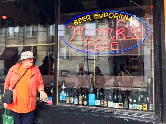 Arlette Figdore of Conewago Township is ready to see the drink specials at Monk Cafe in Philadelphia.