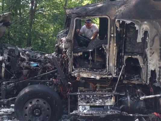 York City Fire Deputy Chief Chad Deardorff  inspects the remains of a truck that burned on Piedmont Drive in York, near Teslin Road.