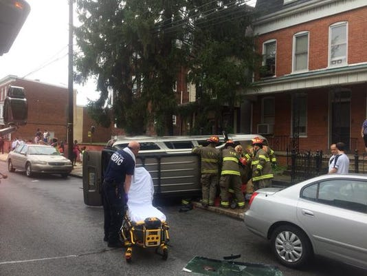 Fire crews work to get two patients out of a vehicle that crashed in York on Thursday.