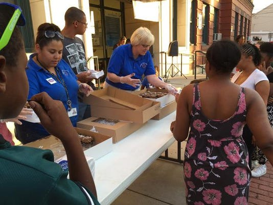 York's Community Progress Council celebrates its 50th anniversary with cupcakes for all as part of National Night Out on Tuesday, Aug. 4, 2015.
