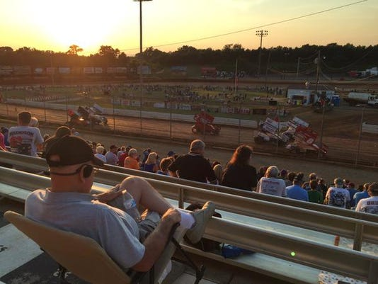 Spectators take in dirt-track racing at Lincoln Speedway on Saturday, August 15, 2015.