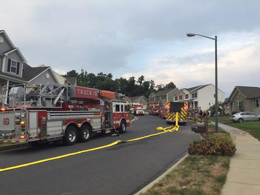 Fire crews respond to a house fire in the 400 block of Chestnut Way on Tuesday, August 18, 2015.