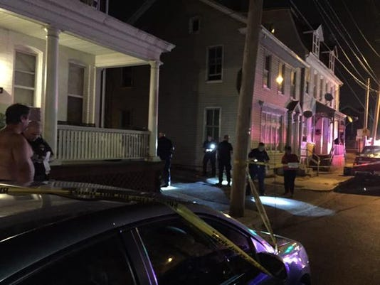 Police investigate a shooting in the 600 block of West King Street on Tuesday, August 18, 2015. A man was shot twice in the leg.
