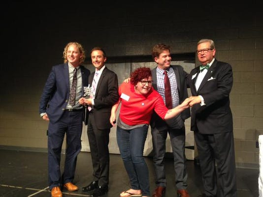 Members of Royal Square accept their Better York beautification award at Downtown Inc's award ceremony on Thursday, September 10, 2015.
