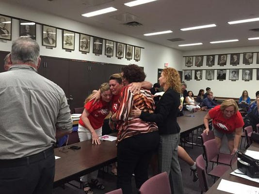 Keep us in Dover Schools members celebrate after a board of education committee recommended on Sept. 16, 2015 that a petition to move Washington Township to a different school district be denied.