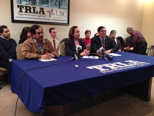 From left, Socorro residents Alberto Ortiz, Irma Sanchez, and attorney Alberto Mesta announce a lawsuit against the city of Socorro Wednesday.