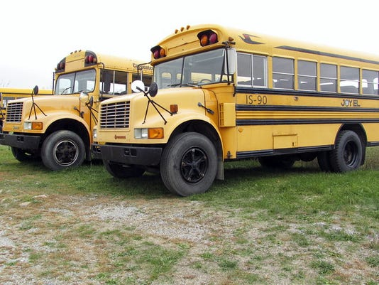 The buses that Camp Joy El uses to transport students between school and the camp's release time do not have swinging stop signs attached to the side or other features that official school buses are required to have. The organization that runs the camp claims in a lawsuit that a state police trooper misinterpreted the law in ordering the camp's buses off the road.