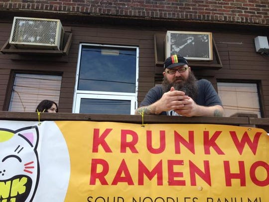 Sam Aeun stands outside his new Des Moines restaurant, Krunkwich Ramen House, on opening day Wednesday.