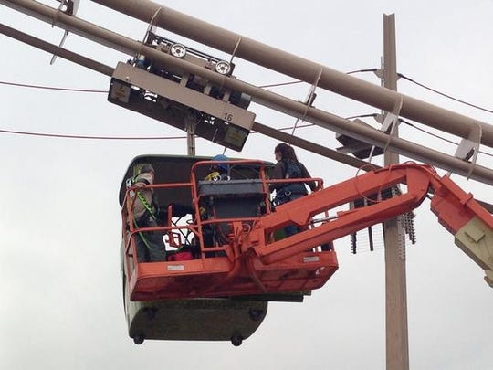Indianapolis Fire Department and Indianapolis Zoo officials rescue people trapped in the sky car at the zoo's orangutan exhibit Sunday.