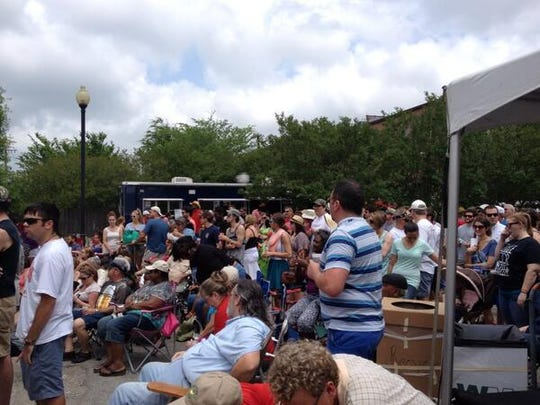 The crowd at LA Craft Biergarten Stage listens to Lafayette band Roaming Signals.