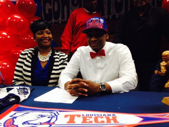 Huntington's Aaron Roberson, right, signed with Louisiana Tech on Wednesday.
