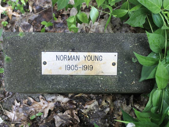 Of the 14 boys buried in the woods, Norman Young presents the biggest mystery.