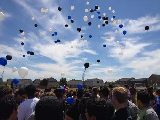 Friends and family gather at Houck Middle School to remember Sean Kaleopa
