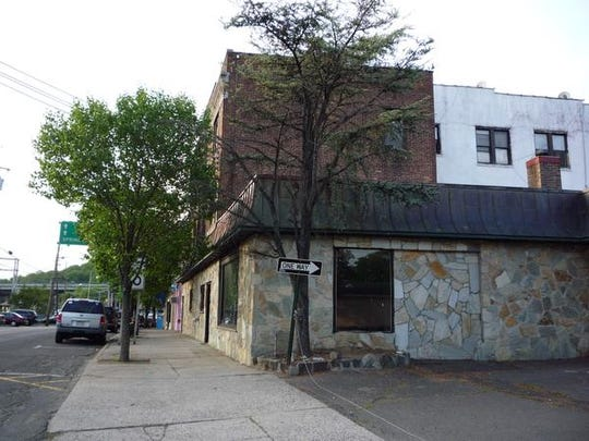 The building at 122 Orange Ave. building will be torn down under a plan by Orange Avenue Associates for luxury rental apartments.
