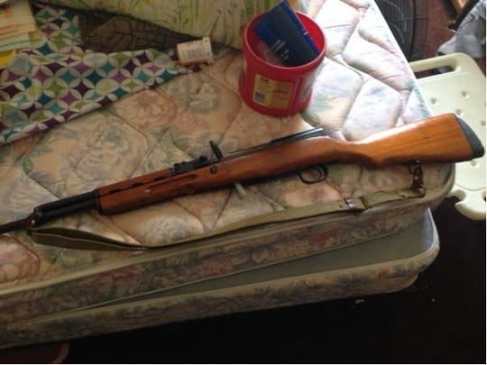Police located a 7.62 SKS semi-automatic rifle at the home of Darrell Dixon.
