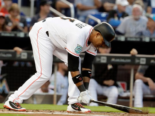 Miami Marlins' Starlin Castro pounds his bat into the dirt after striking out in the first inning of a baseball game against the Boston Red Sox, Monday, April 2, 2018, in Miami. (AP Photo/Lynne Sladky)