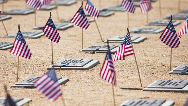 Flags adorn gravestones on Memorial Day and other occasions at the National Memorial Cemetery of Arizona. Flags mark every grave at the National Memorial Cemetery of Arizona Memorial Day observances in Phoenix, Monday, May 26, 2014.