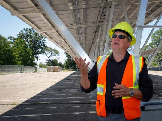 """""""These parking bays will take care of five, maybe six percent of energy costs here on campus,"""" Wolfgang Bauer, an MSU physics professor and senior consultant to the Executive Vice President said Thursday at the MSU solar parking bays within lot 89."""