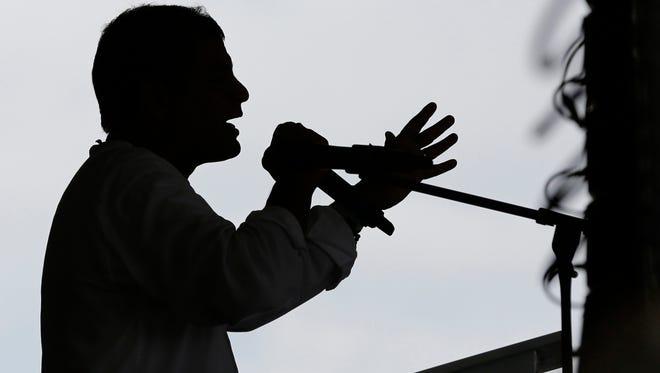 In this Jan. 16, 2014 file photo, Ecuador's President Rafael Correa speaks at the opening of the Comunidad del Milenio Panacocha in Ecuador's Amazon region.