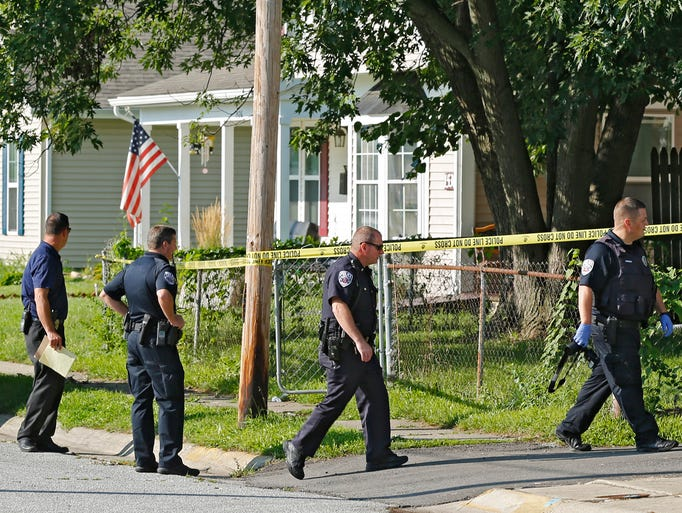 Police investigate the scene after the body of a man was discovered around 9:15 a.m. Wednesday, August 20, 2014, in the 1500 block of N. 16th Street.