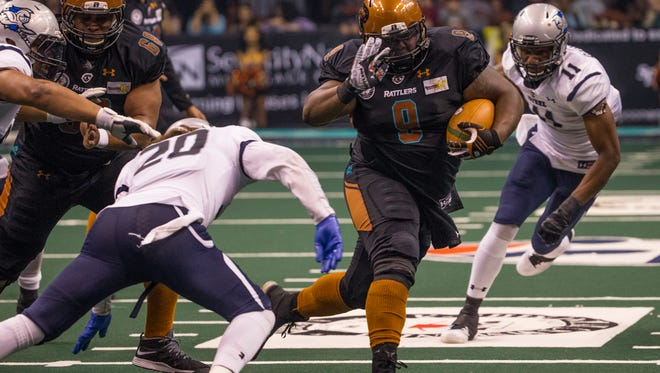 Mykel Benson (9) is pictured running for the Arizona Rattlers of the Indoor Football League on June 11, 2016, in Phoenix, Ariz.
