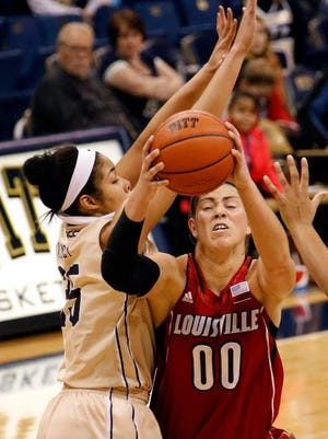 Louisville's Sara Hammond (00) goes to the basket against Pittsburgh's Stasha Carey (35) during the second half of an NCAA women's college basketball game in Pittsburgh Sunday, Jan. 4, 2015.(AP Photo/Tom E. Puskar)