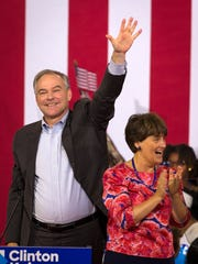 Sen. Tim Kaine, D-Va., waves toward the crowd alongside his wife, Anne Holton, after speaking with Hillary Clinton at a campaign rally at Florida International University on July 23, 2016.