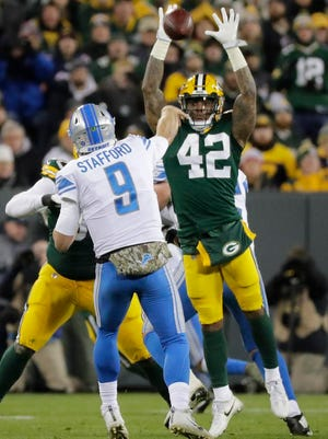Green Bay Packers strong safety Morgan Burnett (42) pressures Detroit Lions quarterback Matthew Stafford (9) in the third quarter at Lambeau Field on Monday, November 6, 2017 in Green Bay, Wis.