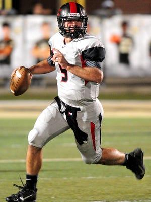 Brandon High School quarterback Gardner Minshew (9) searches for an open receiver during a game against Oak Grove High School Friday.