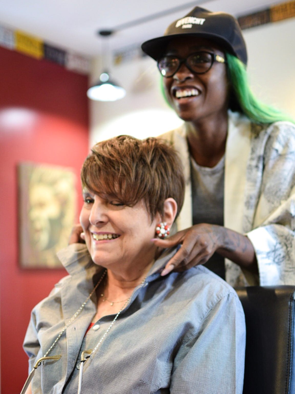 Rabbi Lynne Landsberg's former hairstylist in Washington, D.C., Quarita Futrell from On The Runnn, drove down to Staunton with her sister to fashion a wig for Landsberg, who lost her hair from chemotherapy. Landsberg's stylist Grail Ogzewalla from The Shop in Staunton let them use the salon.