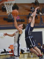 Franklin's Dalton Gasior (left) goes in for the layup against Thurston defender Matteo Maisano.