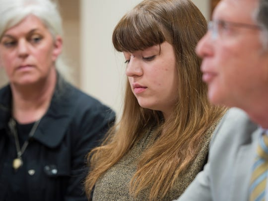 Miranda Lewis, 23, of Chester, center, sits with her mother, Marina, and attorney Irwin Zalkin during a news conference at Gravel & Shea in Burlington on Tuesday announcing two lawsuits against the Bellows Falls Congregation of Jehovah's Witnesses and Tract Society of New York.