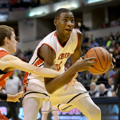 Park Tudor's Jaren Jackson Jr., is fouled by Frankton's Austin Compton,left, during their ISHAA 2A State Championship game. The Park Tudor Panthers defeated the Frankton Eagles 73-46 to win the IHSAA 2A Boys Basketball State Final Saturday, March 28, 2015, at Bankers Life Fieldhouse.