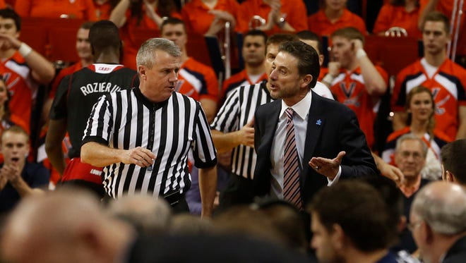 Louisville's Rick Pitino, right, questions a call during an NCAA college basketball game against Virginia, Saturday, Feb. 7, 2015, in Charlottesville, Va. (AP Photo/The RichmondTimes-Dispatch, Joe Mahoney)